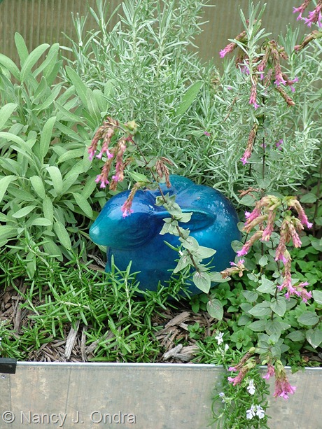 Blue glass bunny in an herb planter at Hayefield