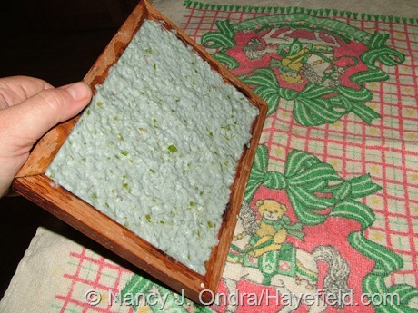 Flipping filled paper mold onto drying towel