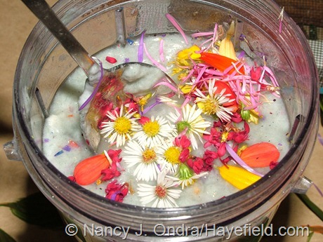 Stirring flowers and petals into already-blended paper pulp