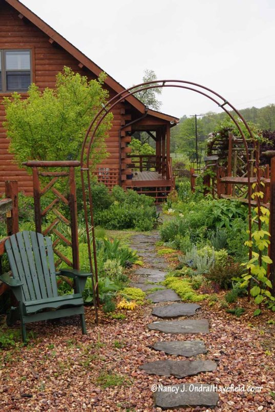 New arbor in the courtyard [Nancy J. Ondra/Hayefield.com]
