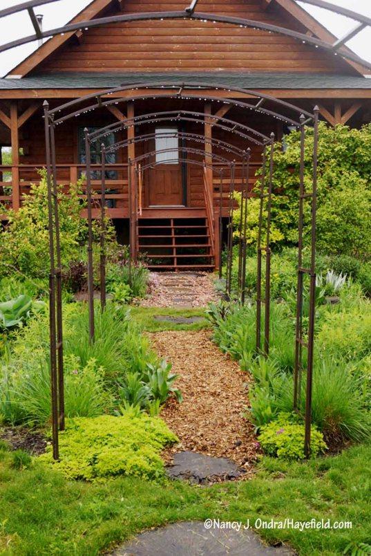 New arbors in the side garden [Nancy J. Ondra/Hayefield.com]